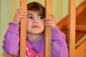 45835225 - sad girl looks at here fighting parents at home before bedtime.concept photo of child, childhood, family, problems, divorce ,abuse, violence.